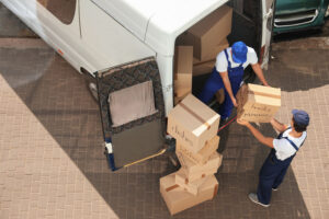 Movers Unloading Moving Boxes from the Moving Van