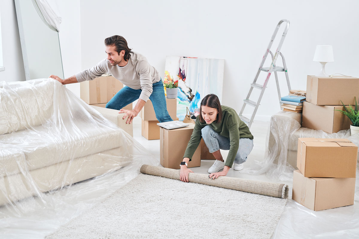 A Couple Packing a Living Room for Moving